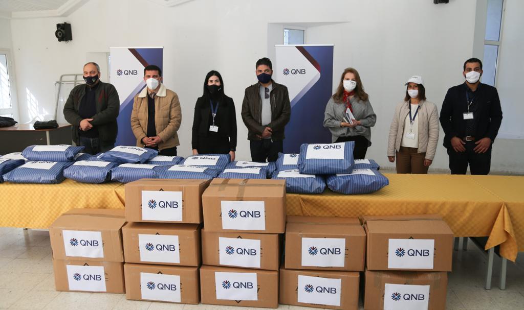 QNB يرافق أطفال تالة من أجل شتاء دافئ: